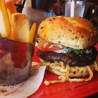 Photo taken at Red Robin Gourmet Burgers by Angela O. on 11/5/2014