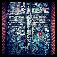 Photo taken at Asylum Sports Bar Grill & Nightclub by Acts of Random Art on 11/27/2012