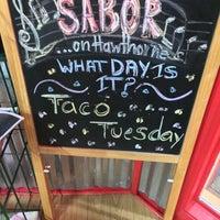 Photo taken at Sabor Latin Street Grill by Martina V on 4/1/2015