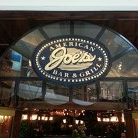 Photo taken at Joe's American Bar & Grill by Ken T. on 3/14/2013