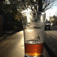 Photo taken at Lucky Labrador Tap Room by Brewvana T. on 4/3/2013