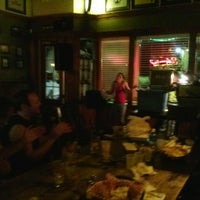 Photo taken at Mulligan's Irish Pub by Kelly S. on 7/24/2013