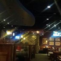 Photo taken at Boston's Restaurant & Sports Bar by Michael C. on 3/20/2014