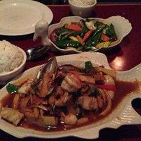 Photo taken at Thai Basil Restaurant by Susie P. on 3/23/2013