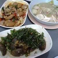 Photo taken at ร้านข้าวต้มปัญญา by Tid T. on 11/6/2012