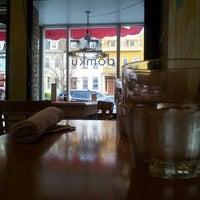 Photo taken at Domku Bar & Cafe by James M. on 4/10/2013