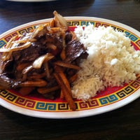Photo taken at Laus Peruvian Food by Liz V. on 4/24/2013