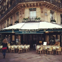 Photo taken at Les Deux Magots by Veronica P. on 12/19/2012