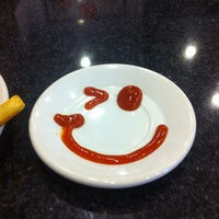 Photo taken at Johnny Rockets by Miriam A. on 3/30/2013