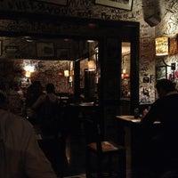Photo taken at La Bodeguita del Medio by Rogelio T. on 12/29/2012