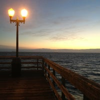 Photo taken at Seal Beach by Raul C. on 3/4/2013