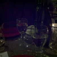 Photo taken at Glass Wine Bar & Bistro by Amy L. on 2/1/2013