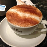 Photo taken at Caffé Nero by Begum A. on 4/16/2013