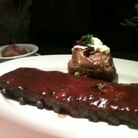 Photo taken at Outback Steakhouse by Erica A. on 3/3/2013