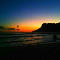 Photo taken at Praia de Guaecá by Felipe B. on 3/31/2013