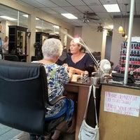 Photo taken at Sandys Oasis Salon by Cyndi D. on 8/31/2013