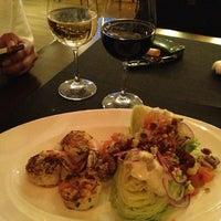 Photo taken at Delmonico's Kitchen by Santiago O. on 3/27/2013