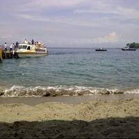 Photo taken at Pantai Senggigi by Kevin I. on 3/28/2013