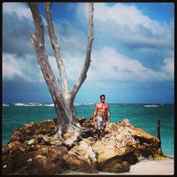 Photo taken at Los Corales Beach by Billy Y. on 1/6/2014