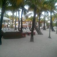 Photo taken at Nikki Beach Miami by Michelle &. on 11/28/2012