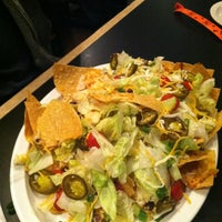 Photo taken at Manny's Sports Tavern & Grill by Lindsey D. on 12/21/2012