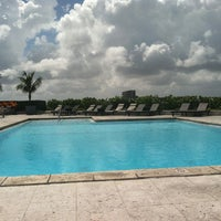 Photo taken at Hilton Hotel Rooftop Pool by Monica T. on 8/21/2013