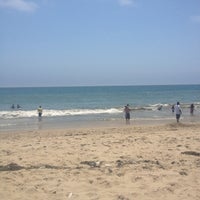 Photo taken at Pacific Palisades Beach by Erin H. on 7/4/2013