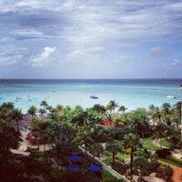 Photo taken at Marriott's Aruba Surf Club by Jason U. on 12/24/2012