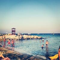 Photo taken at Konnos Beach by Alexander P. on 7/21/2013