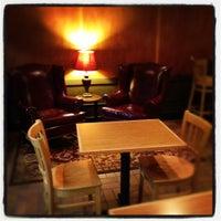 Photo taken at Atomic Coffee by Patrick on 1/29/2012