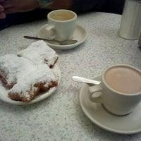 Photo taken at Café Du Monde by Michelle H. on 11/13/2011