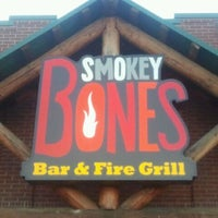 Photo taken at Smokey Bones Bar & Fire Grill by Joey D. on 11/2/2011