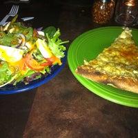 Photo taken at CRISP Pizza Bar & Lounge by Misha K. on 8/20/2011