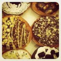 Photo taken at Krispy Kreme by Manlee L. on 7/15/2012
