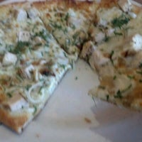 Photo taken at California Pizza Kitchen by Rachel P. on 6/25/2012