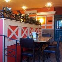 Photo taken at Pizza Ollis by Roman Z. on 4/1/2012