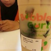 Photo taken at BubbleGurt Cafe by Nurin Qistina J. on 5/16/2013
