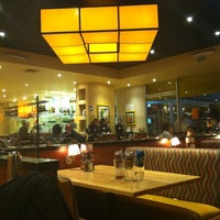 Photo taken at California Pizza Kitchen by Saraí C. on 12/23/2012