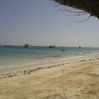 Photo taken at Los Corales Beach by Anabelle H. on 9/23/2012