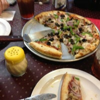 Photo taken at Mark Twain's Pizza Landing by Tom A. on 1/3/2013