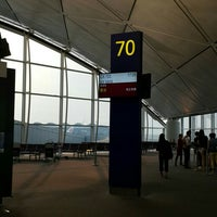 Photo taken at Gate 70 by Lorraine Y. on 10/21/2015