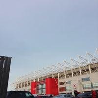 Photo taken at Riverside Stadium by Michelle U. on 12/14/2013