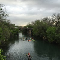 Photo taken at Barton Springs Pedestrian Bridge by Adele H. on 4/3/2015