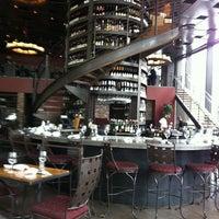 Photo taken at Purple Café & Wine Bar by Joy C. on 3/22/2013