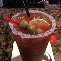 Photo taken at Hurricane's Bar & Grill by Ashley S. on 10/29/2011