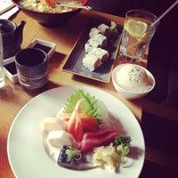 Photo taken at Symphony Sushi by Gloria C. on 5/8/2013