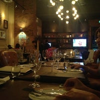 Photo taken at D' vine Wine Bar & Tapas by Amy C. on 3/17/2013