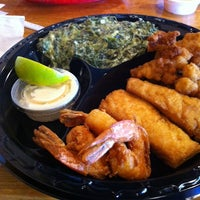 Photo taken at Captain Jim's Seafood by Marsha Brady C. on 1/19/2014