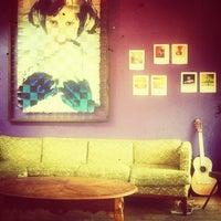 Photo taken at Zona Rosa Caffe by KS K. on 7/1/2013