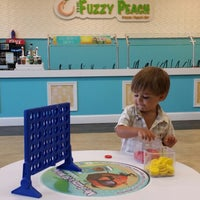 Photo taken at The Fuzzy Peach by Gabrielle L. on 6/29/2014